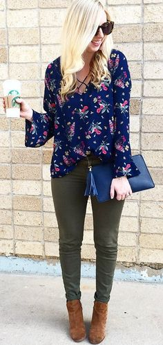 c94e9622e63 Floral top with criss cross top and bell sleeves! Paired with olive  skinnies and navy   cognac accessories!