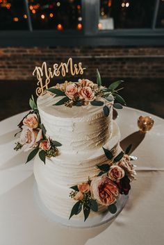 Wedding cake, thick frosting, peach roses, Mr. & Mrs. cake topper, repin to your own wedding inspiration board // Elizabeth Lloyd Photography