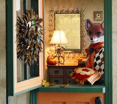 Mrs. Fox greets at an entrance adorned with a Pier 1 Feather Wreath in Peacock Green