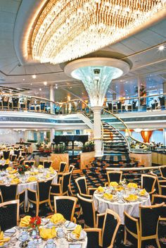 Vision of the Seas | Complimentary, multi-course dining for all meals of the day? Yes please. The main dining hall on all Royal Caribbean ships makes cruise dining a delicious breeze.