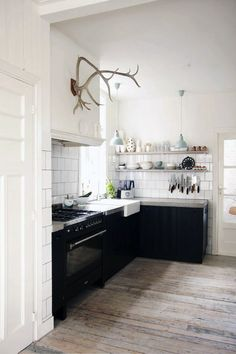 Black lower cabinets and white upper with white subway tile.