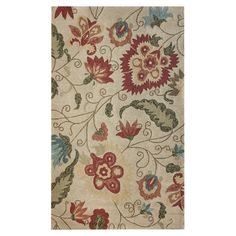 Ivory-hued rug with a flowing floral motif.   Product: RugConstruction Material: 100% Polypropylene...