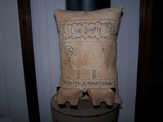 My newest creation ~ Live Simply Stitchery Pillow and two little sheep bowl fillers.  The pillow is available here:  http://www.etsy.com/listing/97545347/primitive-handmade-stitchery-pillow-with