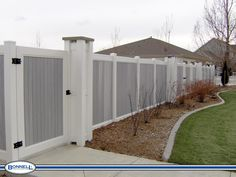 Grey and White Vinyl Privacy Fence