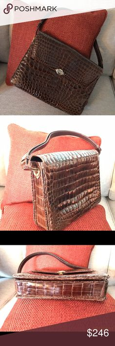 Sant'Agostino Pelletterie purse VINTAGE & unique!!! Alligator? Crocodile? This beauty will be great on your shoulder whether on a date/girls night out. Gently loved. 1950-60ish. Absolutely gorgeous purse! Adj. shoulder strap. 4 Different compartments, one zippered. Zipper tab has designer's name engraved. 3 Very tiny, barely noticeable wear spots on one side of zippered pocket. Pic is magnified and makes wear look worse than it really is. Bottom has very minor, barely visible wear. About…