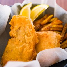 Moist, tender fish fillets wrapped in a light crispy beer batter, served with crunchy twice fried chips. The trick to making sure everything stays crispy until it hits the table is to double fry them.