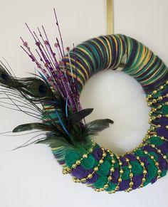 Mardi Gras Wreath, Multicolor Yarn and Felt - 14 inch size. $45.00, via Etsy.  @Katie Bohannon @Ashley Besco @Amy Abendschein