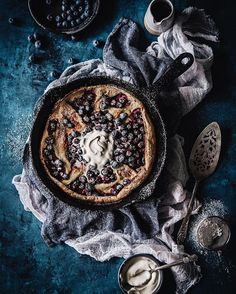 Hot jammy blueberry dutch baby meets melty creme fraiche over on… Dark Food Photography, Pancakes And Waffles, Creme Fraiche, Edible Art, Baby Food Recipes, Brunch Recipes, No Bake Cake, Food Pictures, Food Styling