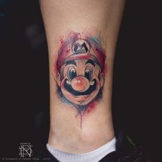 What does mario tattoo mean? We have mario tattoo ideas, designs, symbolism and we explain the meaning behind the tattoo. Nintendo Tattoo, Gaming Tattoo, Tattoos For Kids, Little Tattoos, Love Tattoos, Tattoos For Women, Tatoos, Super Mario, Mario Bros.