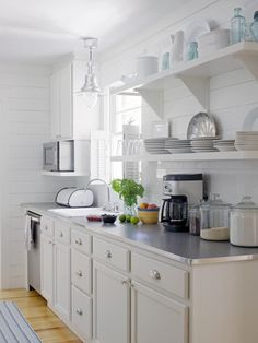I love the light fixture over sink and open shelves. 30 Bright and White Kitchens : Kitchen Remodeling : HGTV Remodels - Home Decorating DIY Beach House Kitchens, Cottage Kitchens, Home Kitchens, Updated Kitchen, New Kitchen, Kitchen Dining, Dining Room, Small White Kitchens, Dream Beach Houses