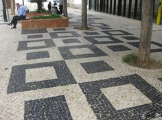 Pavements in Lagos with the original gpattern of squares on sidewalk