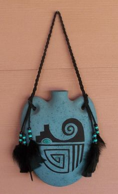 Southwest Indian Native American Style Canteen Wall Hanging Decor. $26.00, via Etsy.