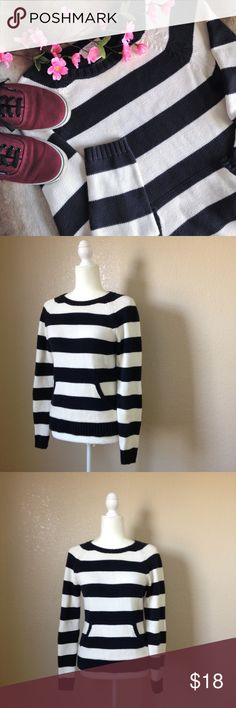 """LOFT Navy Blue & White Striped Pullover Sweater Super cute and cozy sweater from Ann Taylor LOFT, in navy blue and white stripes. Features round neck, ribbed trim and front kangaroo pocket. Good used condition, there's some slight pilling and a very small stain on the left sleeve as pictured. Size S, approximate measurements when laid flat are 16.5"""" bust and 23.5"""" long. LOFT Sweaters Crew & Scoop Necks"""