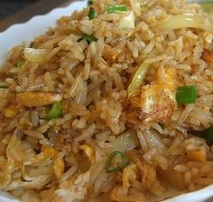 Delicious Crab Fried Rice recipe...2 cups of long grain rice. 2 tbsp peanut oil or olive oil. 4 1/2 oz or 125 grams of canned white crab meat, drained. 1 cup of bean sprouts. 2 eggs beaten. 1 leek sliced. 1 tbsp of light soy sauce. 1 tsp sesame oil 2 tsp of lime juice. Salt to taste. 1 lime sliced, to garnis