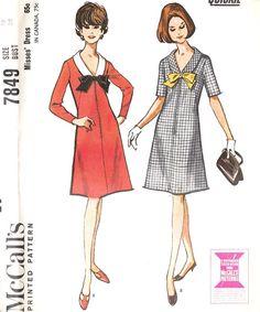 1960's v- line collar dress
