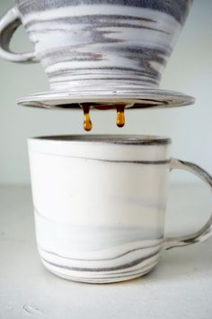 This wheel-turned pour over cone is a beautiful way to start your morning romance with your favorite coffee by bringing out the rich aroma and true flavor of your beverage. The perfect combination of porcelain and clay is individually hand mixed to create each piece with its' own unique marbling pattern. Combine it with a matching mug and youve got yourself a doozy.