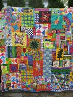 leftovers/kitchen sink quilt Now this quilting is my style Love Love it.