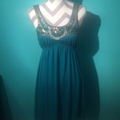 Turquoise Sequin Detailed Dress Turquoise dress with bronze/gold/brown/turquoise sequins and beading. Worn very few times and is in great condition! No rips, stains, or holes, and comes from a smoke free home! Dresses Mini