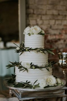 Publix wedding cake with green garnishes. #weddingcake #weddingphotography  wedding inspiration wedding ideas  wedding cakes wedding cake pictures