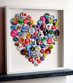 I should do this with all those pins from Cons I have lying around..