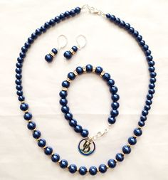 University of Delaware college themed jewelry set. I ordered the UD charm online and made the jewelry from glass pearls in royal blue, gold plated beads and  sterling silver hardware - I liked the mixture of gold and silver for this set.