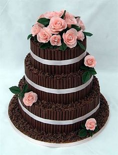 chocolate cigarillos and pink roses wedding cake by sugarlicious ltd - http://www.sugarliciousonline.com