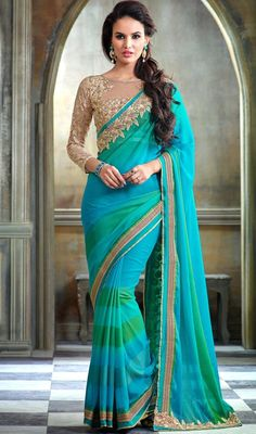 Put your best look forward at wearing this turquoise color embroidered chiffon sari. The lace, resham and stones work personifies the complete look. Upon request we can make round front/back neck and short 6 inches sleeves regular saree blouse also. #onlinechiffonsaree #fancysaris #extraordinarydesignsarees