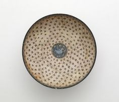 Bowl | Origin: Iran | Period: 13th century Saljuq period | Details: Not Available | Type: Stone-paste with underglaze decoration | Size: H: 10.4 W: 19.5 cm | Museum Code: F1910.9 | Photograph and description taken from Freer and the Sackler (Smithsonian) Museums.