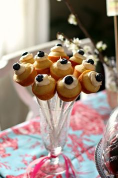 Mini cupcakes on a stick adds height and pizzazz to any party table!