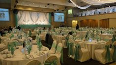 White and 'Tiffany' coloured wedding decor. Classy. At Riverside Banquet Halls