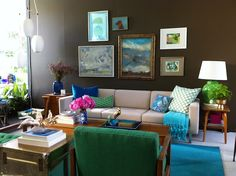 brown living room cream sofa gallery wall blue and green accents