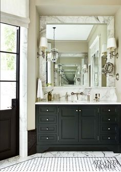 Marble mirror surround, tile, sconces