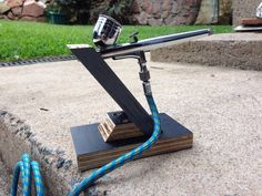 Simple Air Brush stand i made from scrap form ply (film face).