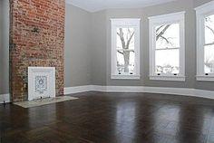 Master Bedroom Renovation Inspiration: color pallet. Exposed red brick, grey walls, white trim, dark floor.