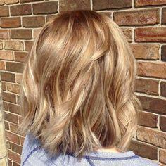 Warm blond balayage on shattered bob hair cut