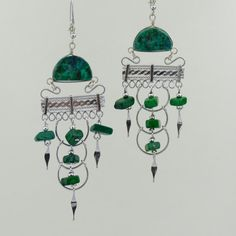 These green chrysocolla stone earrings feature a unique green stone in a beautiful alpaca metal dangling earring design.  These natural stone
