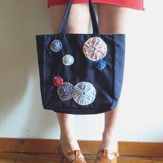 yo yos on a tote bag