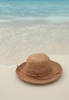 Straw Beach Hat on Shore