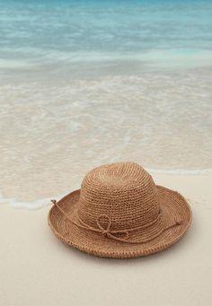Straw Beach Hat on Shore