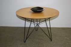 """In 1957 the painter Constant Nieuwenhuys designed this table called """"Ijmuiden"""" for the Dutch company 't Spectrum. Constant Nieuwenhuys is a well known Dutch painter who formed together with Corneille, Karel Appel and some other painters the COBRA groep (Copenhagen, Brussels, Amsterdam)."""
