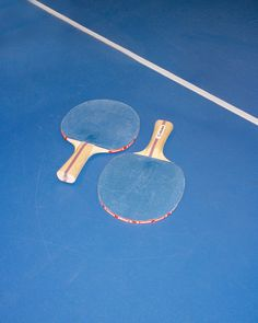 two blue ping pong paddles