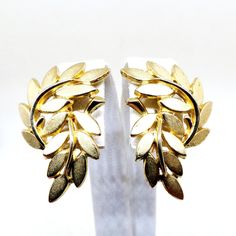 Gold Floral Earrings - Vintage, Crown Trifari Signed, Textured Gold Tone, Floral Leaf Clip-on Earrings by MyDellaWear on Etsy
