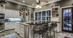 This home is a UNIQUE 3 story Estate is in perfect harmony w its surroundings! full size elevator! Formals, Study, in-house PUB is the gameroom-media w wine storage! Crisp white cabinets in a true chef's kitchen open to LR & DR, SubZero Frig, Dacor 6 brnr gas cktp, massive maple island,...