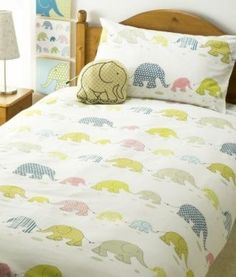 """Annie's idea for this pattern: If one were really good with the sewing machine, the elephants could be patches made from the fabric scrap bag, then it could be like a """"scrap book"""" quilt of memories associated with the former garments!"""