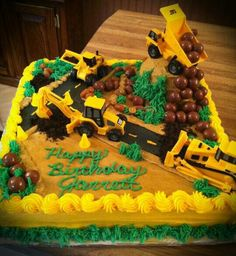 Super cute construction birthday cake! With backhoe, bulldozer, and dump truck.