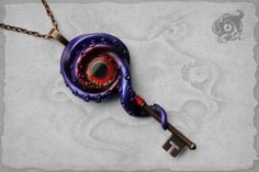 Purple and red Key to R'lyeh kraken pendant by TheArkanaWorkshop