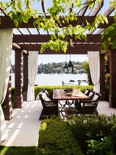 The new alfresco dining pavilion provides a front row-seat to harbor views. Janus et Cie chairs pull up to a table custom designed by Thomas Hamel and fabricated by Beebo Constructions | archdigest.com