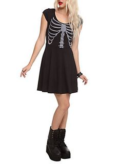 Black dress with rib cage print on the front and braided slashes down the back.