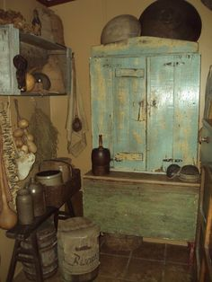 Old Green Cupboard...wood box on the wall filled with old dough bowls...prim crocks.