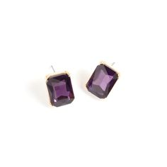 There's a certain regal opulence conveyed by rectangular stone studs, and the Madeline earrings are a shimmering example. Prong-set in gold, Madeline's dark amethyst crystal is unmatched in depth and shine. Madeline will pair beautifully with gold chains.